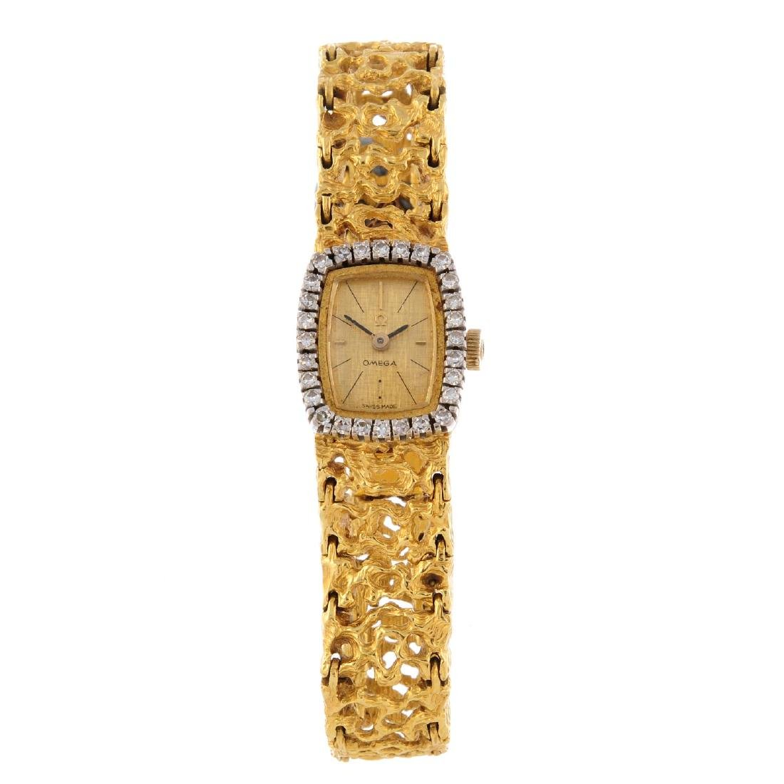 OMEGA - a lady's bracelet watch. Yellow metal case with