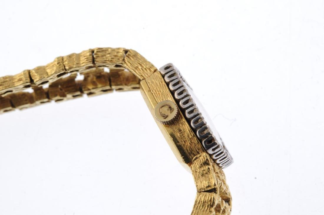 OMEGA - a lady's bracelet watch. Yellow metal case with - 3