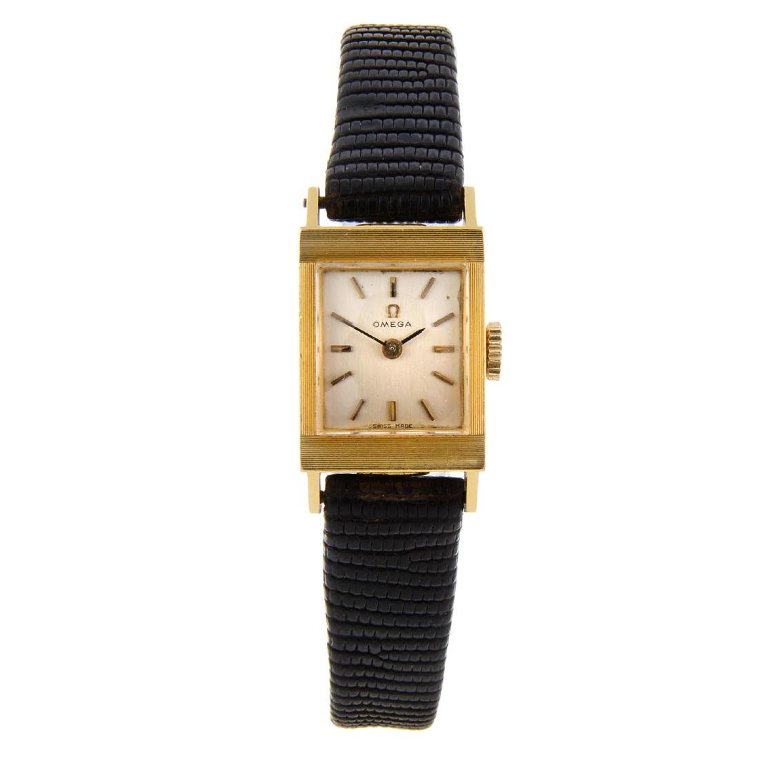 OMEGA - a lady's wrist watch. Yellow metal case,