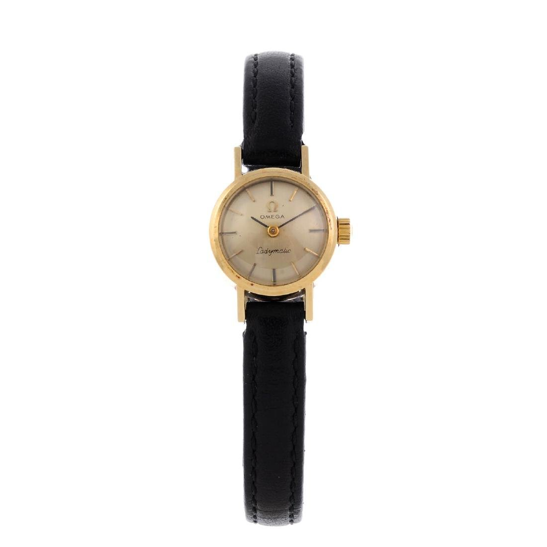 OMEGA - a lady's Ladymatic wrist watch. Yellow metal