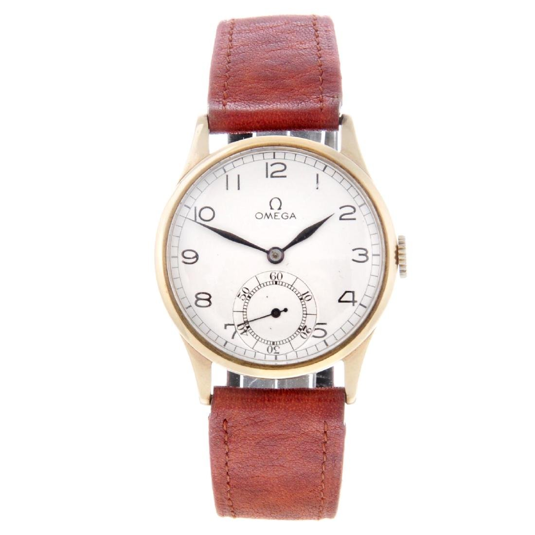 OMEGA - a gentleman's wrist watch. 9ct yellow gold