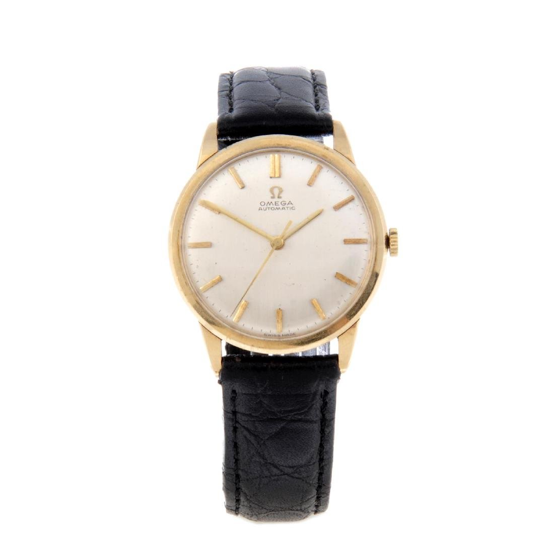 OMEGA - a gentleman's wrist watch. 9ct yellow gold