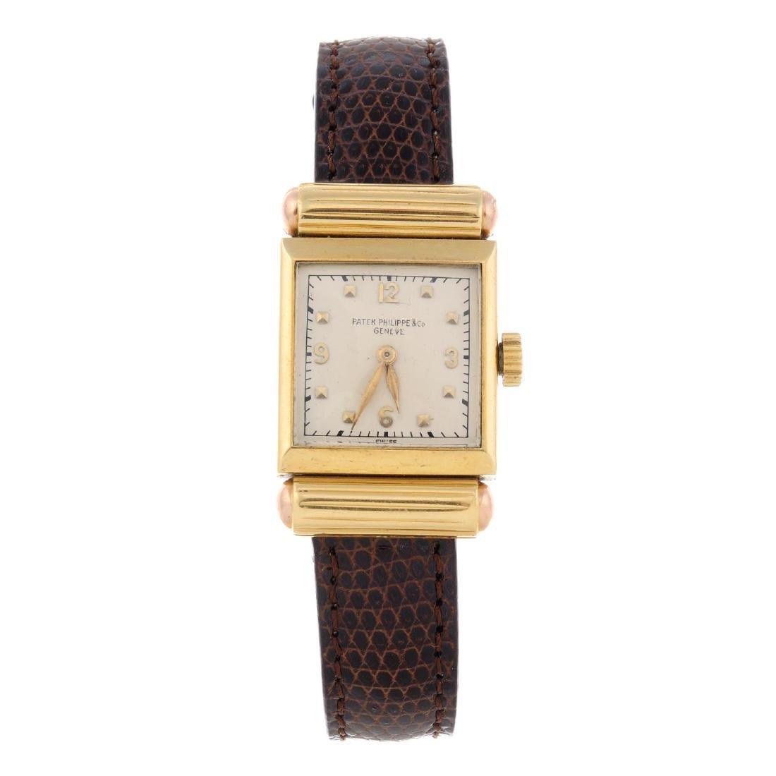 PATEK PHILIPPE - a lady's wrist watch. Yellow metal