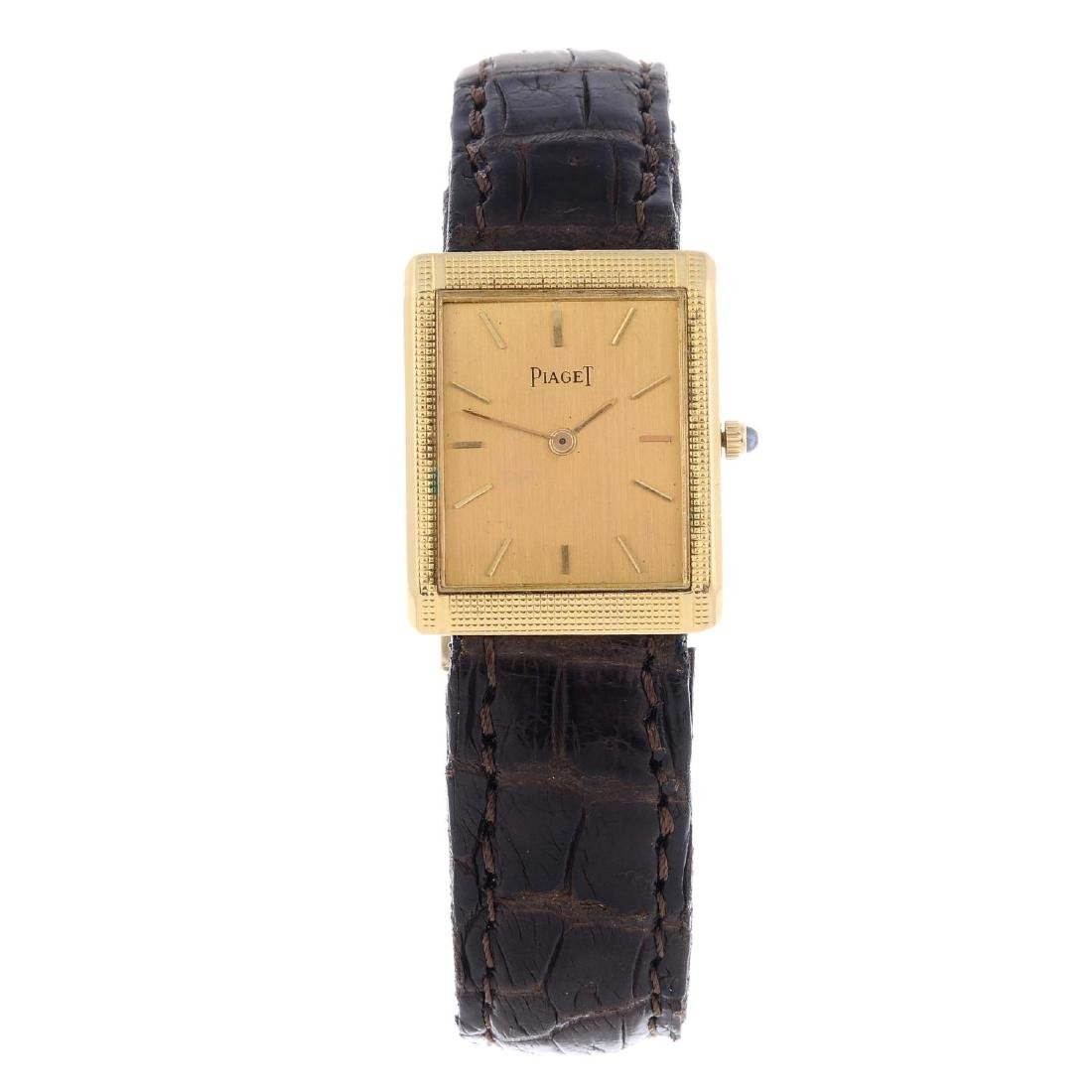 PIAGET - a mid-size wrist watch. Yellow metal case.