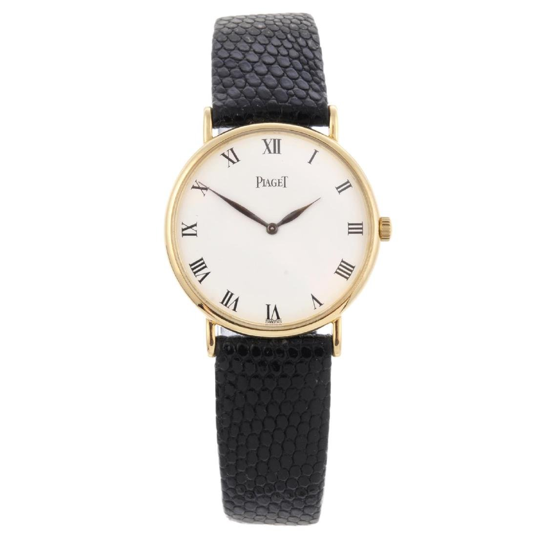 PIAGET - a mid-size wrist watch. Yellow metal case,