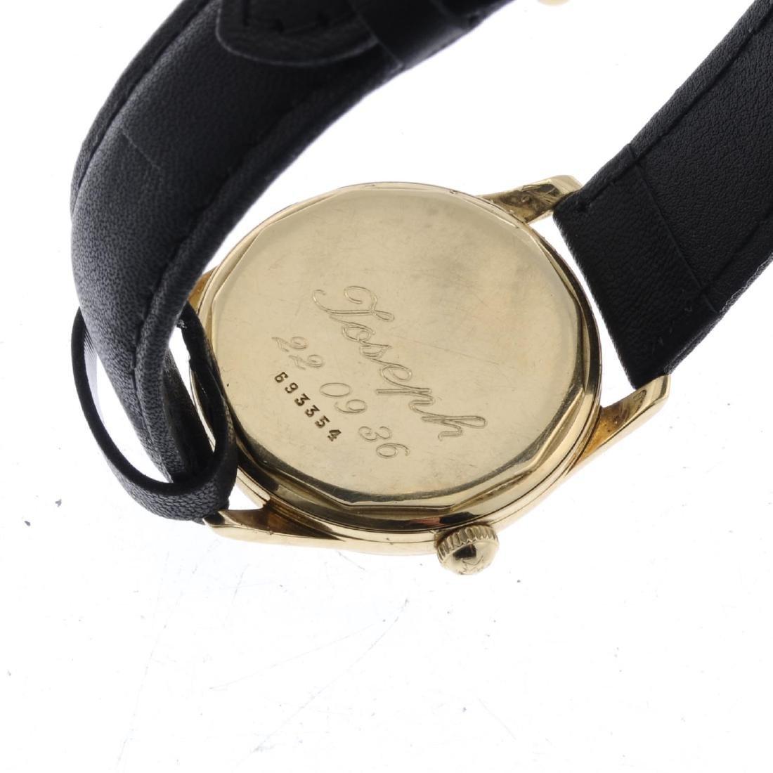 ZENITH - a gentleman's wrist watch. Yellow metal case, - 4