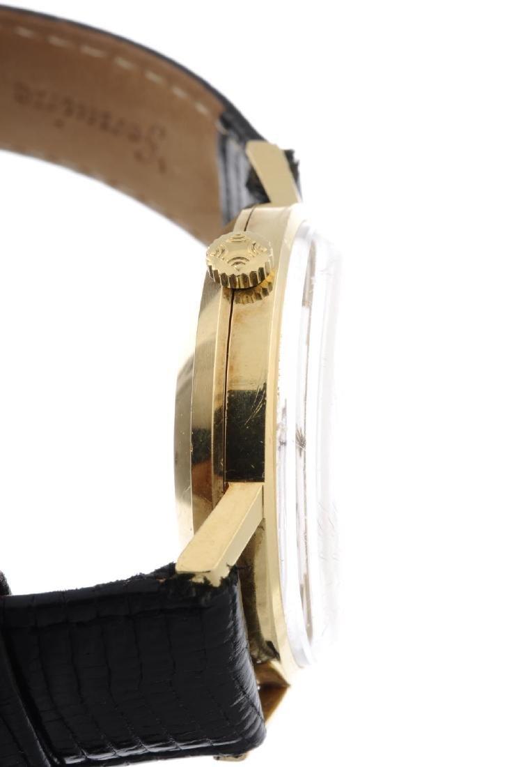ZENITH - a gentleman's wrist watch. Yellow metal case, - 2
