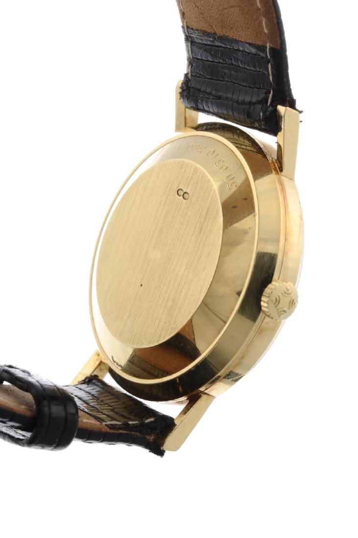 ZENITH - a gentleman's wrist watch. Yellow metal case, - 3