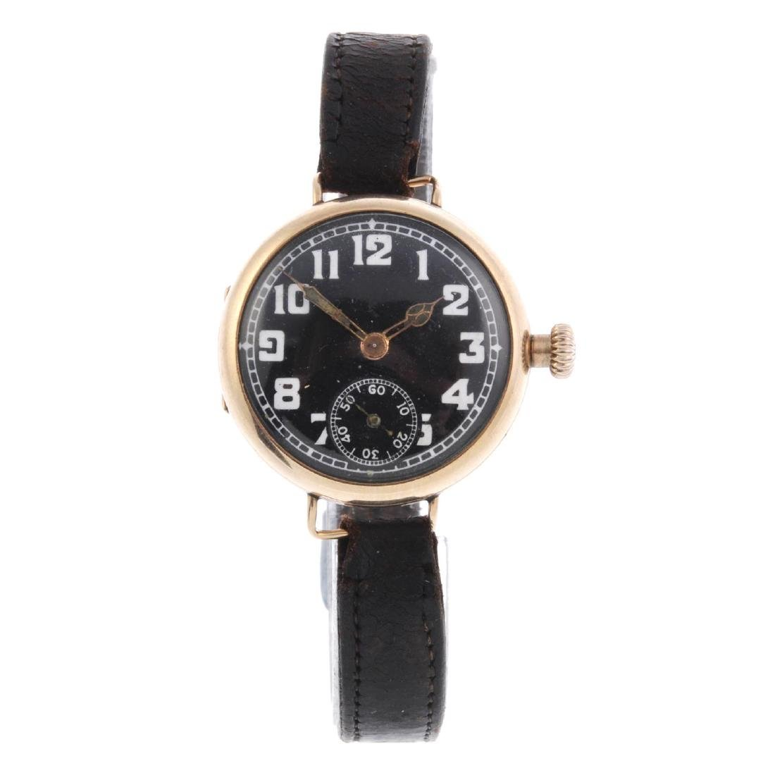 A gentleman's trench style wrist watch. 9ct yellow gold