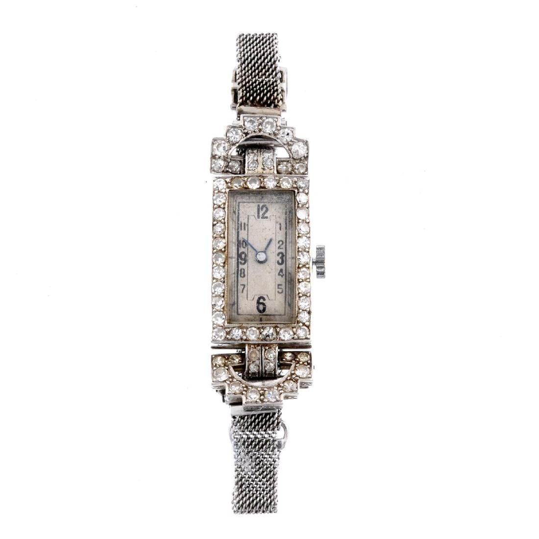 A lady's cocktail watch by Flora Watch Co. White metal