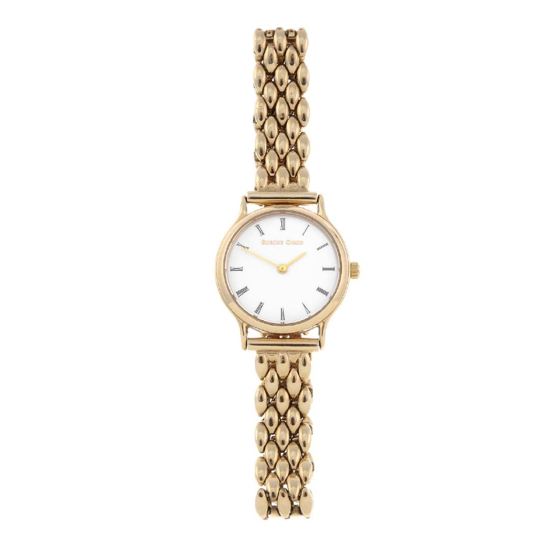 BUECHE GIROD - a lady's bracelet watch. Yellow metal