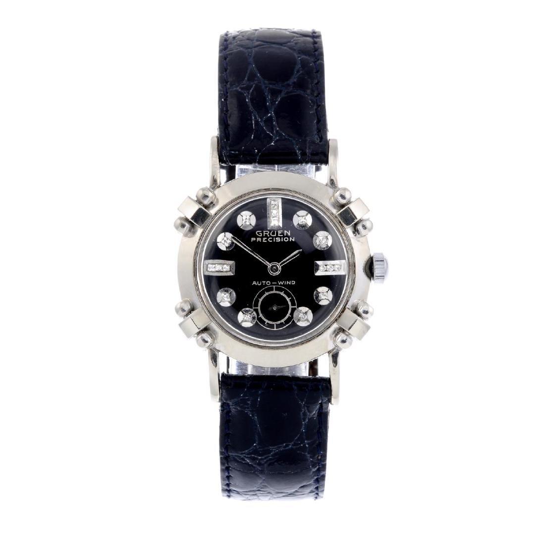 GRUEN - a lady's wrist watch. White metal case, stamped