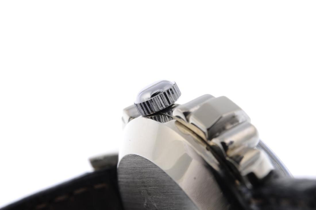 GRUEN - a lady's wrist watch. White metal case, stamped - 5