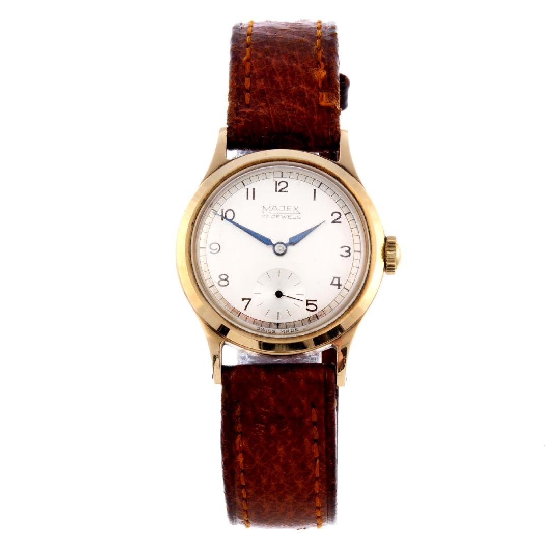 MAJEX - a mid-size wrist watch. 9ct yellow gold case,