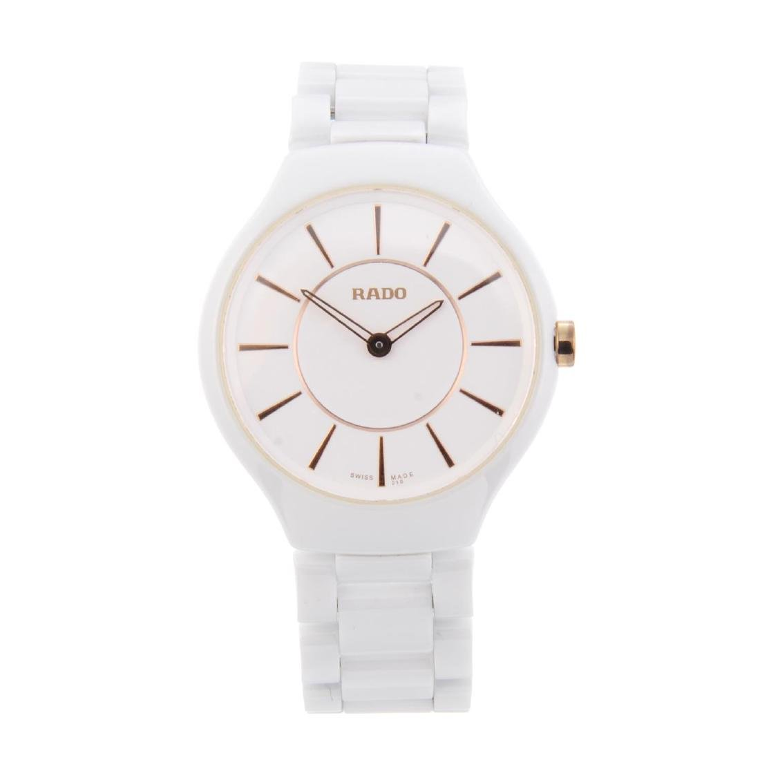 RADO - a lady's True Thinline bracelet watch. White