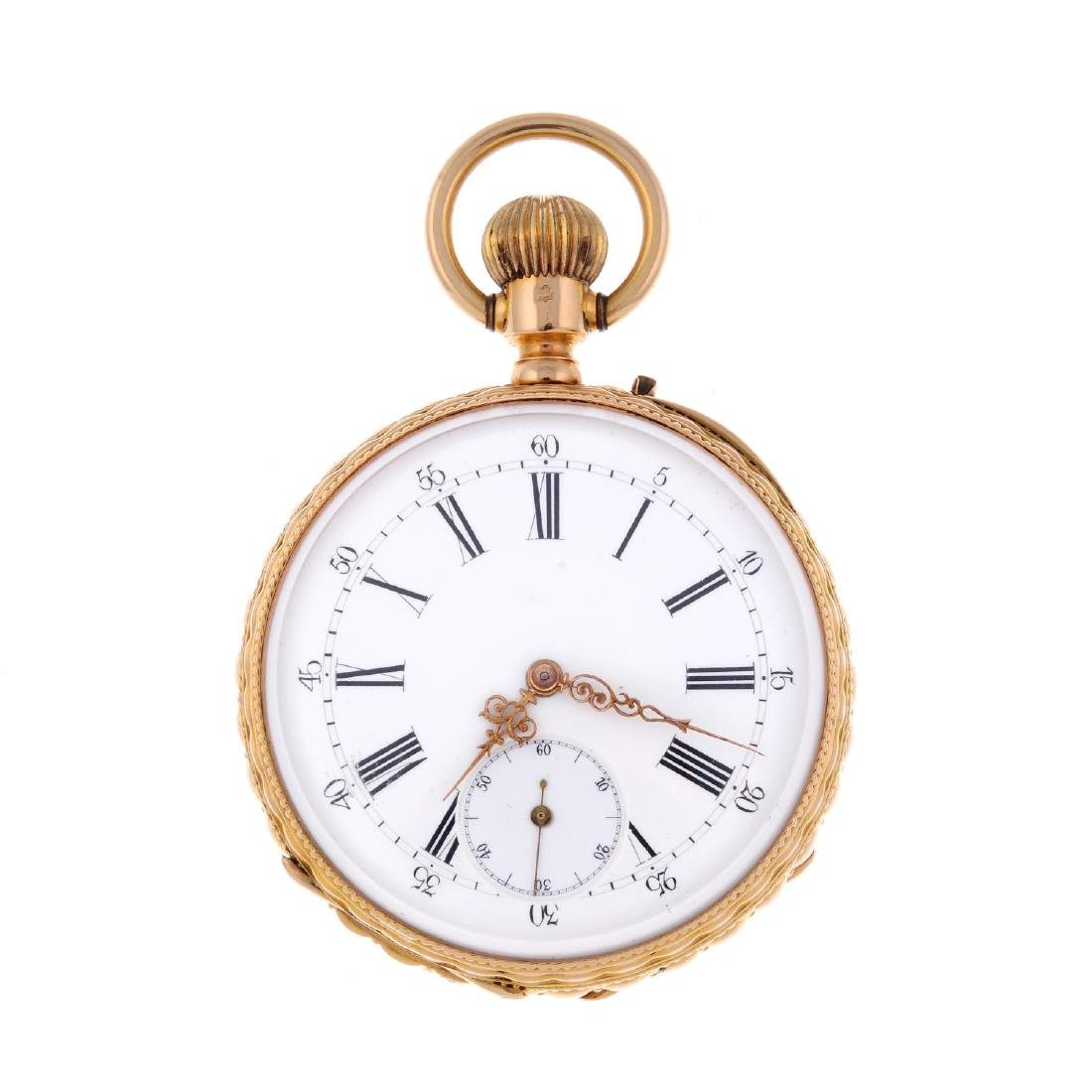 An open face pocket watch. Yellow metal case with