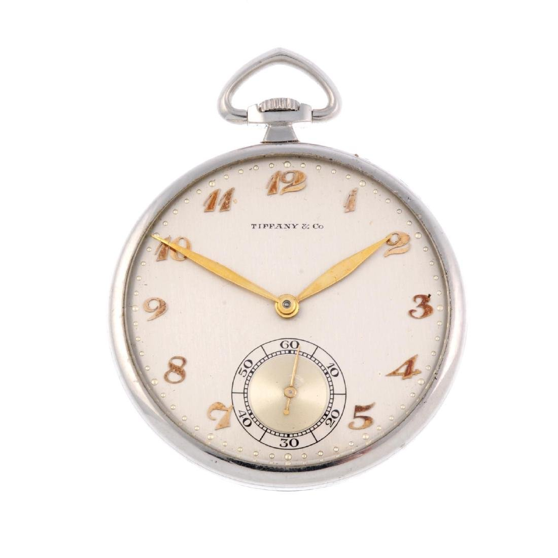 An open face pocket watch by Tiffany & Co. White metal