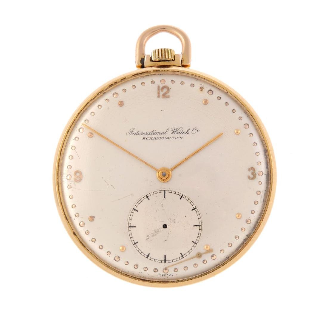 An open face pocket watch by IWC. Yellow metal case,