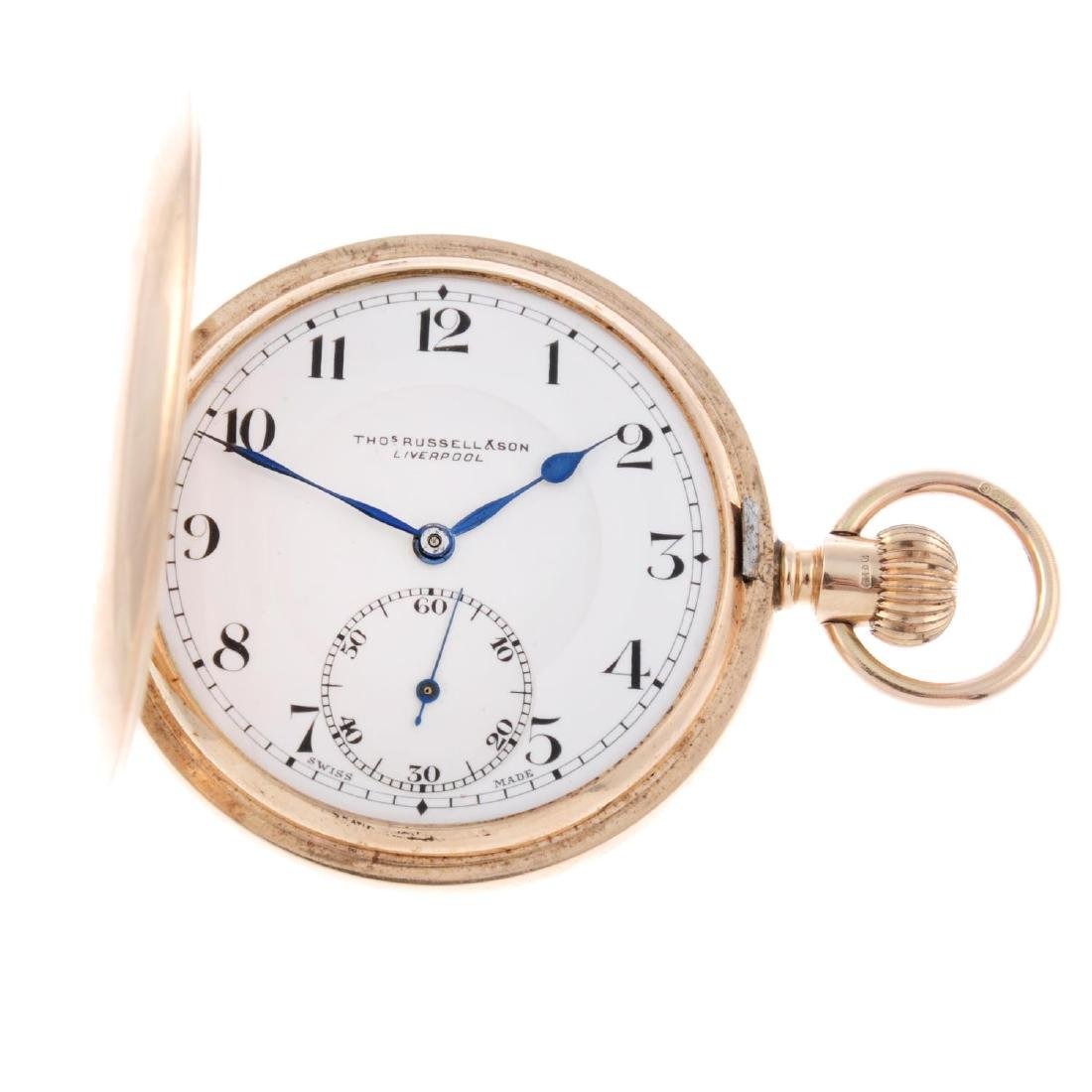 A full hunter pocket watch by T. Russell & Son. 9ct