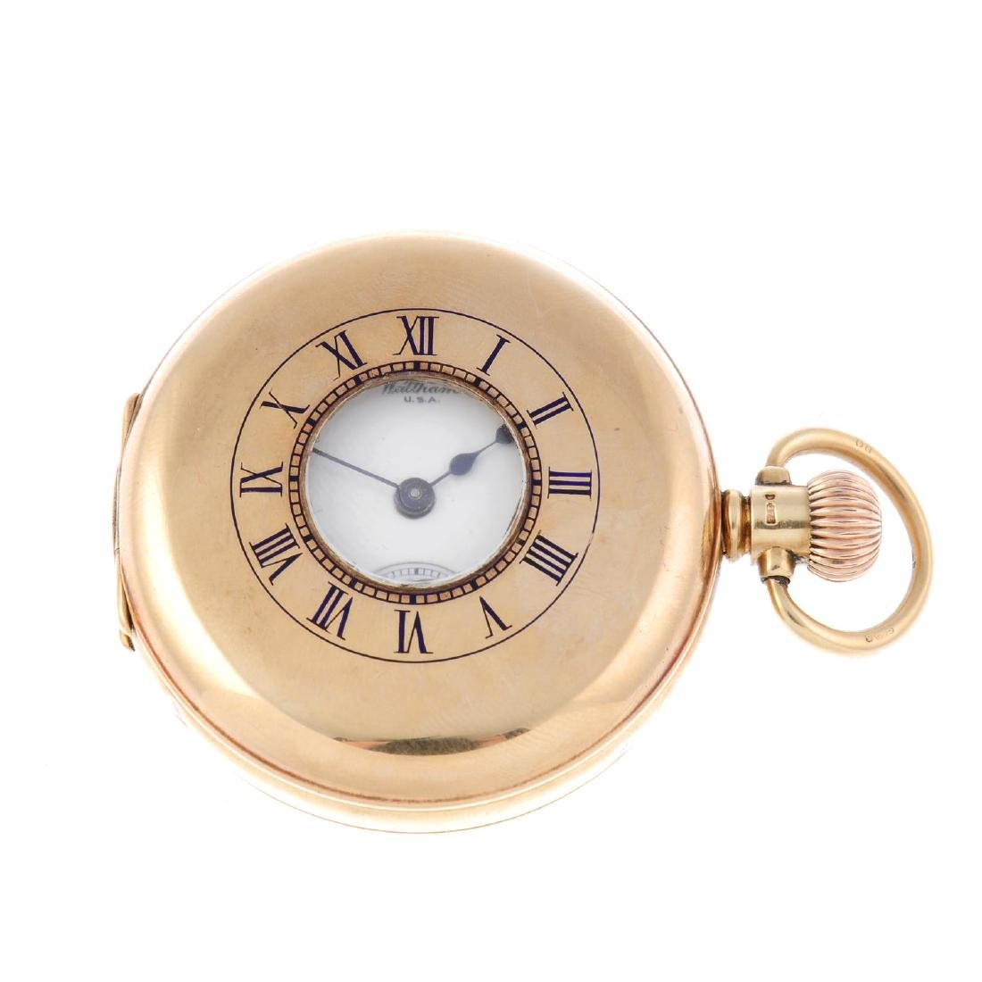 A half hunter pocket watch by Waltham. 9ct yellow gold