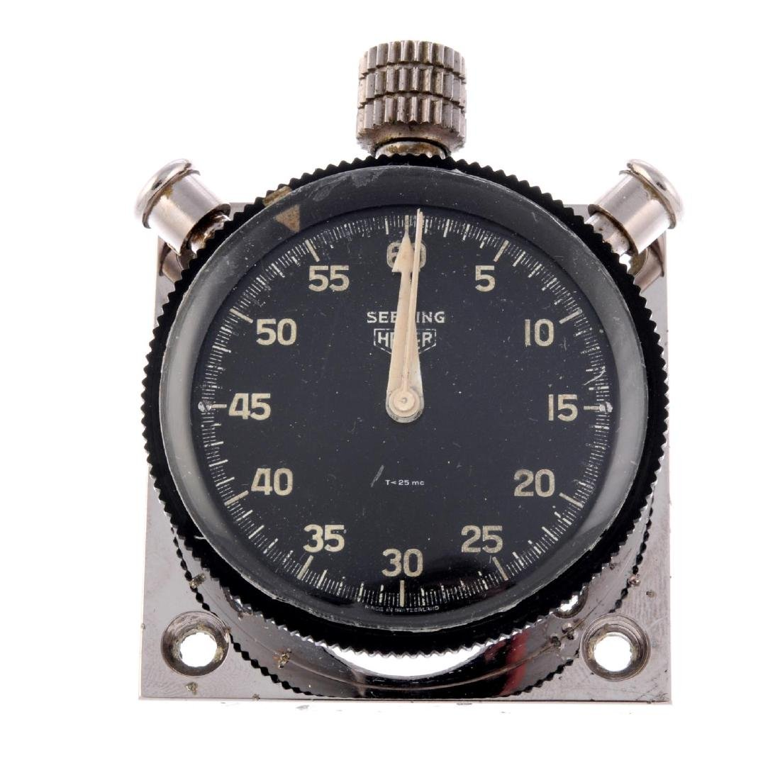 A Sebring dash timer by Heuer. Base metal case with
