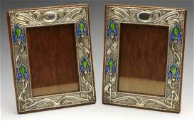 A pair of Art Nouveau silver mounted photograph frames