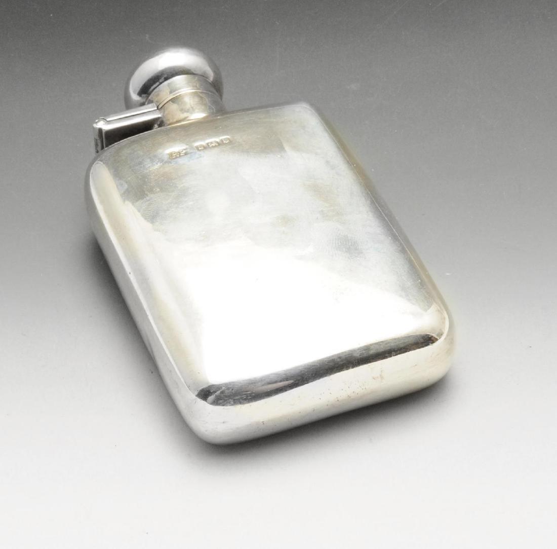 A mid-twentieth century small silver hip flask, of