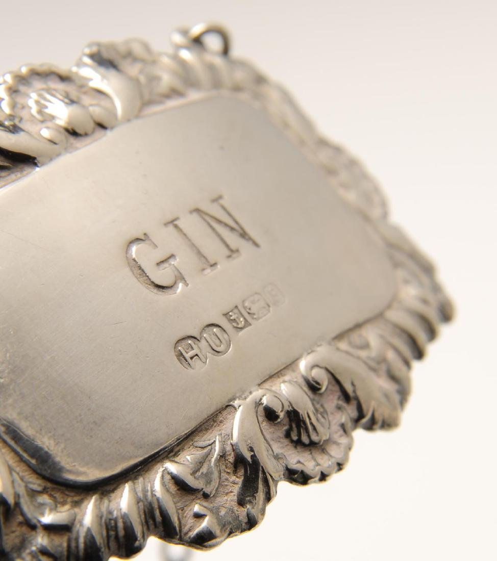 A modern pair of silver wine labels, each of oblong - 2