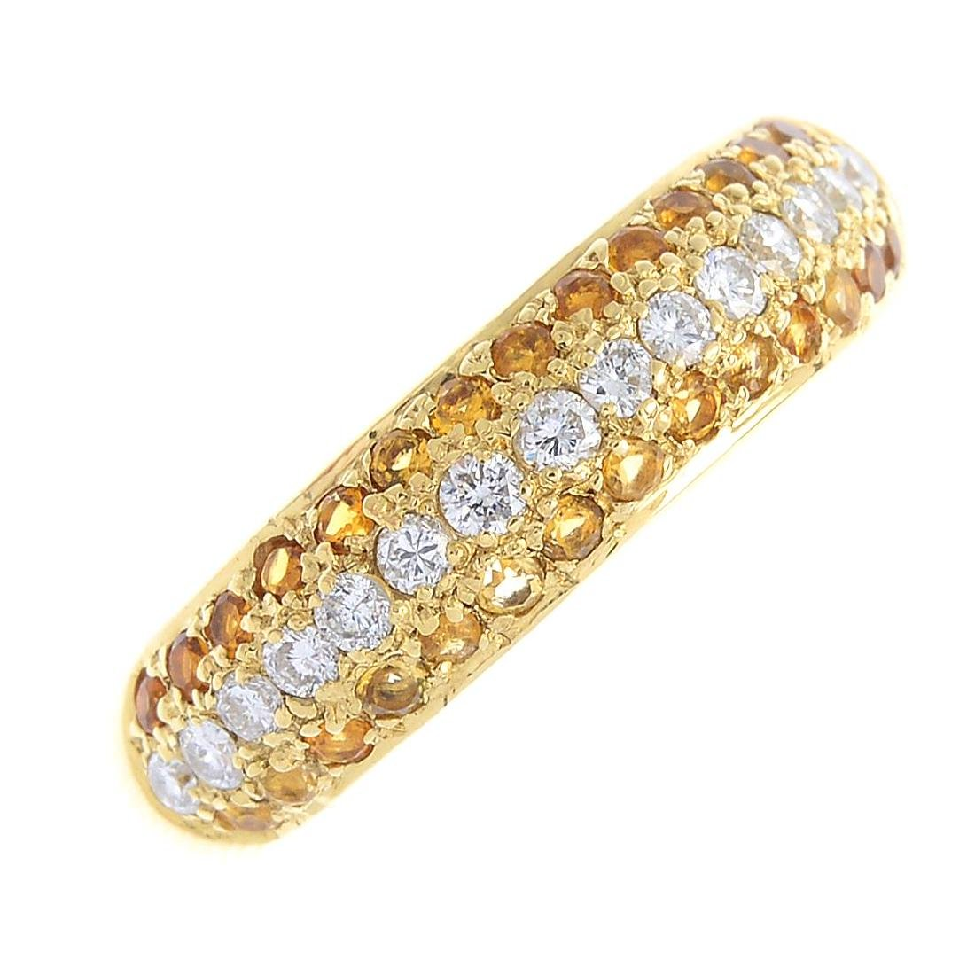An 18ct gold diamond and citrine band ring. The