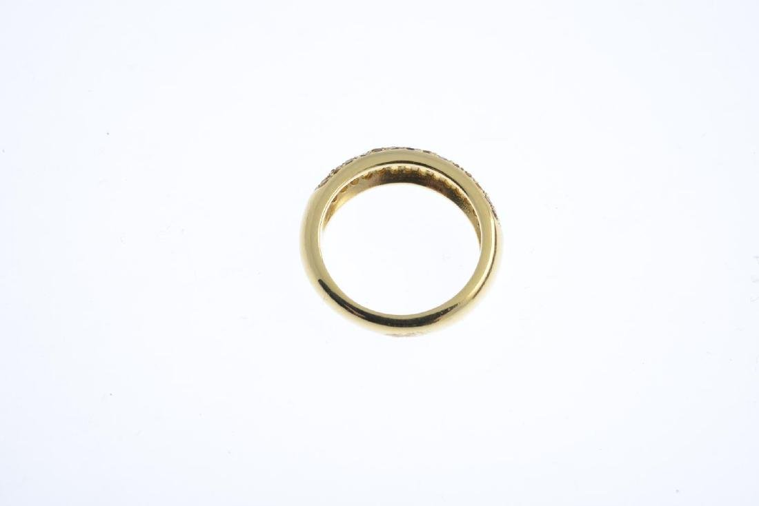 An 18ct gold diamond and citrine band ring. The - 2