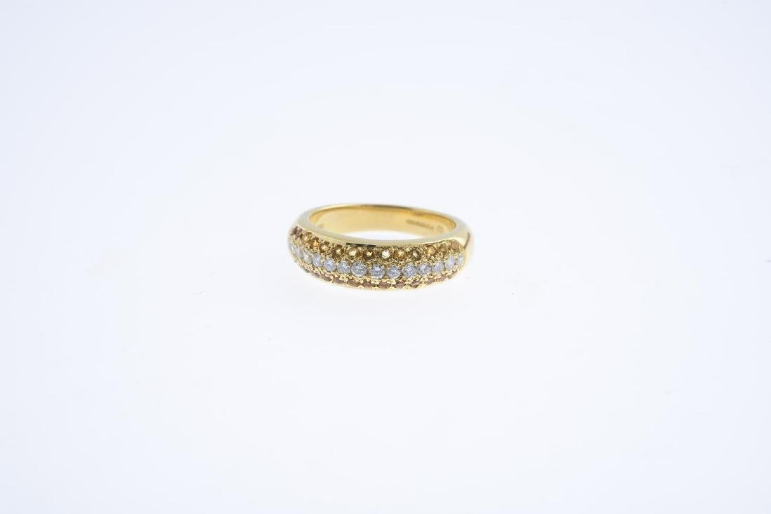 An 18ct gold diamond and citrine band ring. The - 3