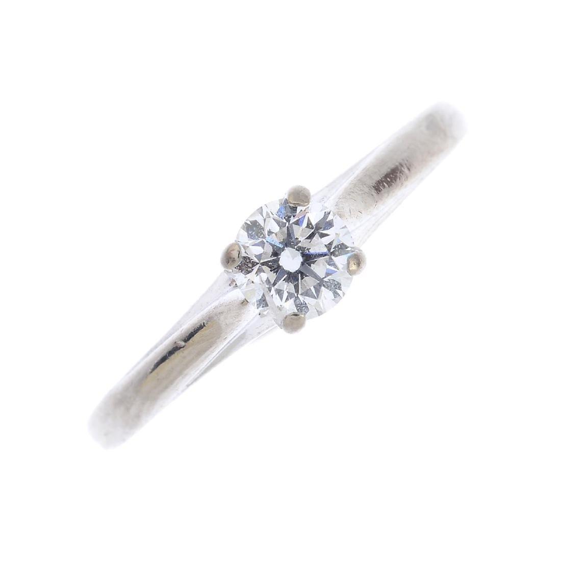 An 18ct gold diamond single-stone ring. The