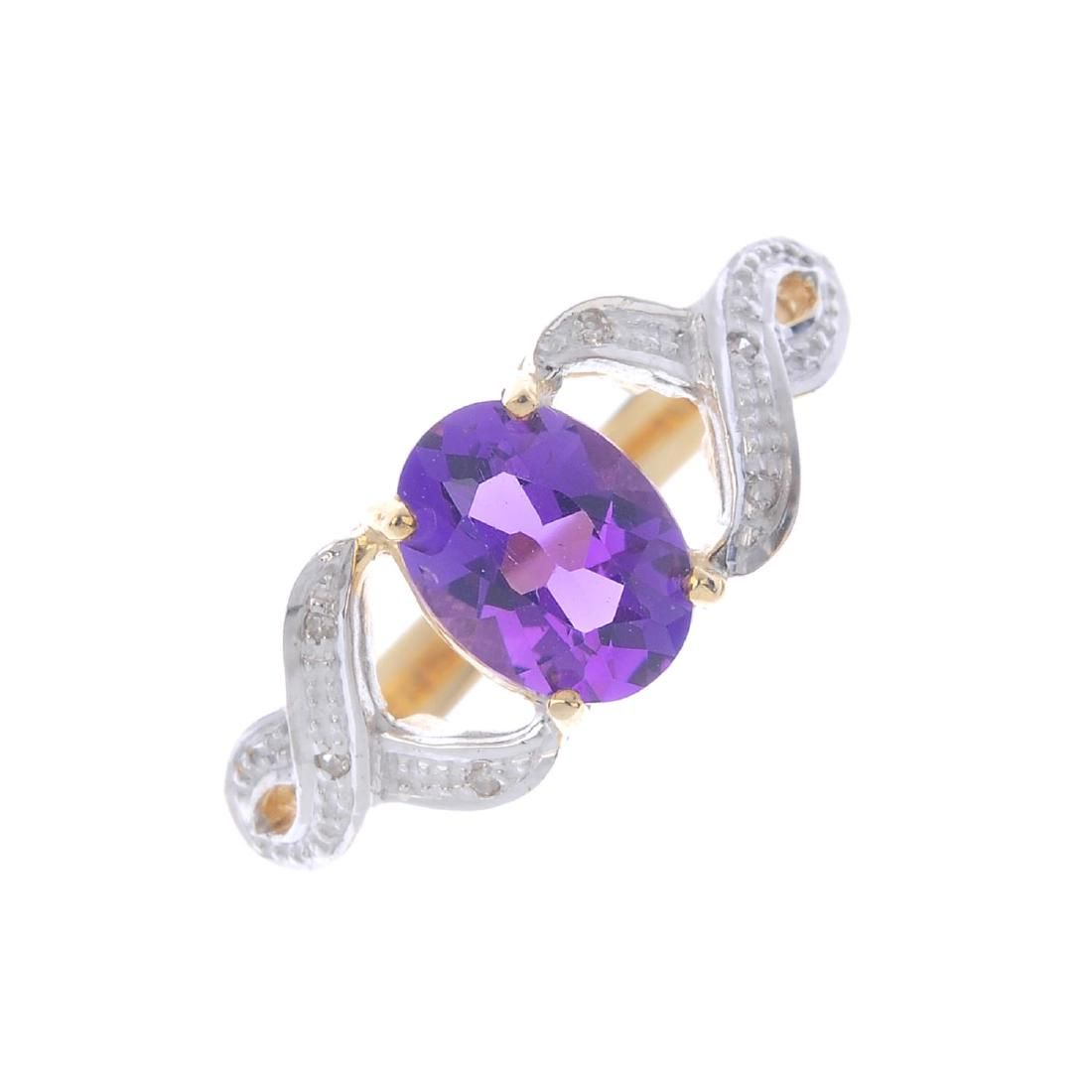 A 9ct gold amethyst single-stone ring. The oval-shape