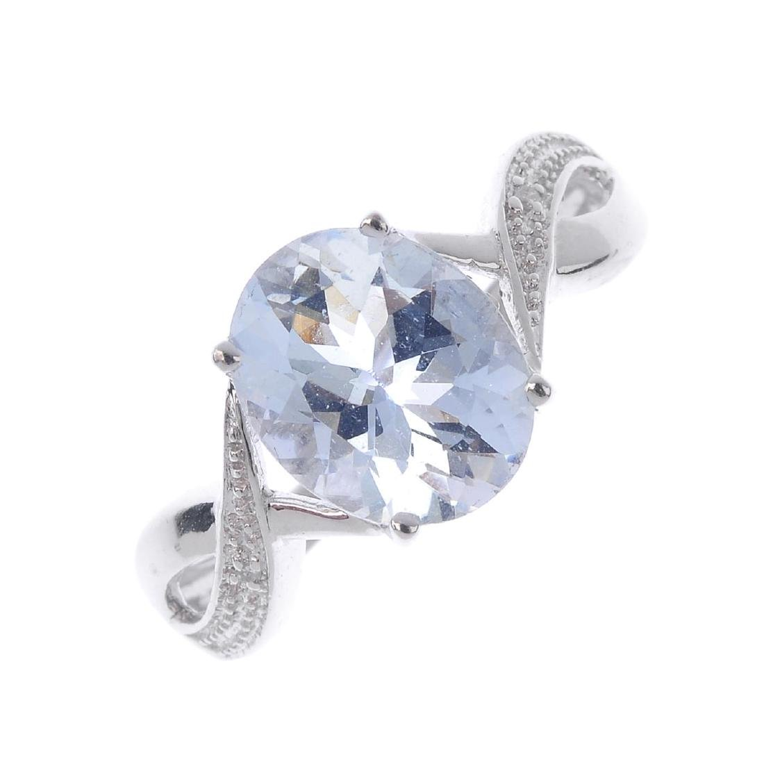 A 9ct gold aquamarine single-stone ring. The oval-shape