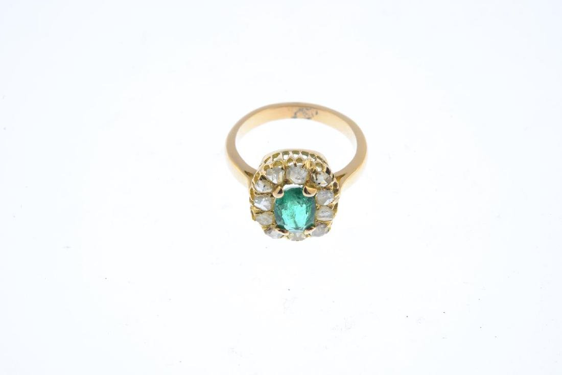 An emerald and diamond cluster ring. The oval-shape - 2