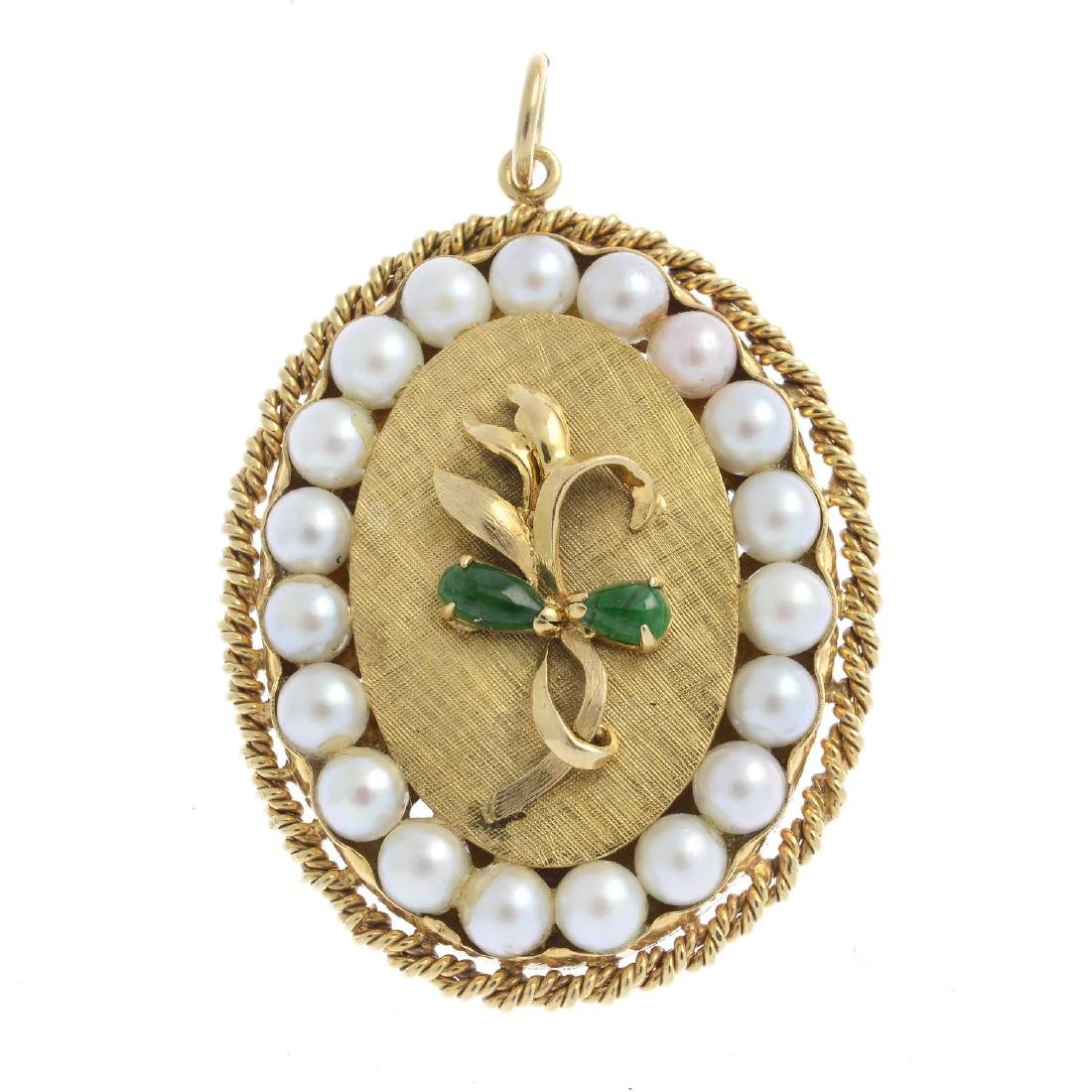 A jade and cultured pearl pendant. The pear-shape