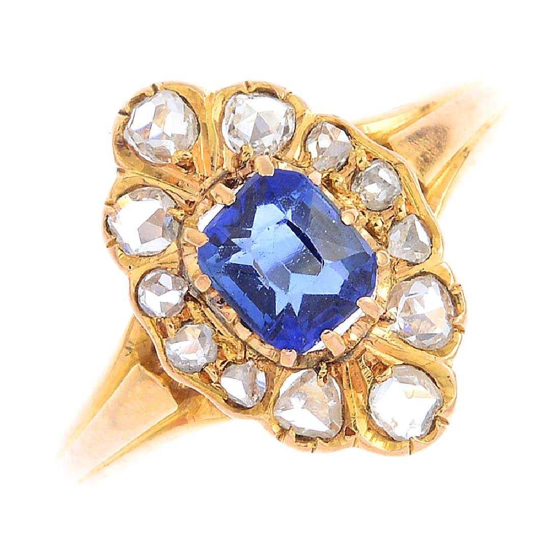 A sapphire and diamond cluster ring. Of marquise-shape