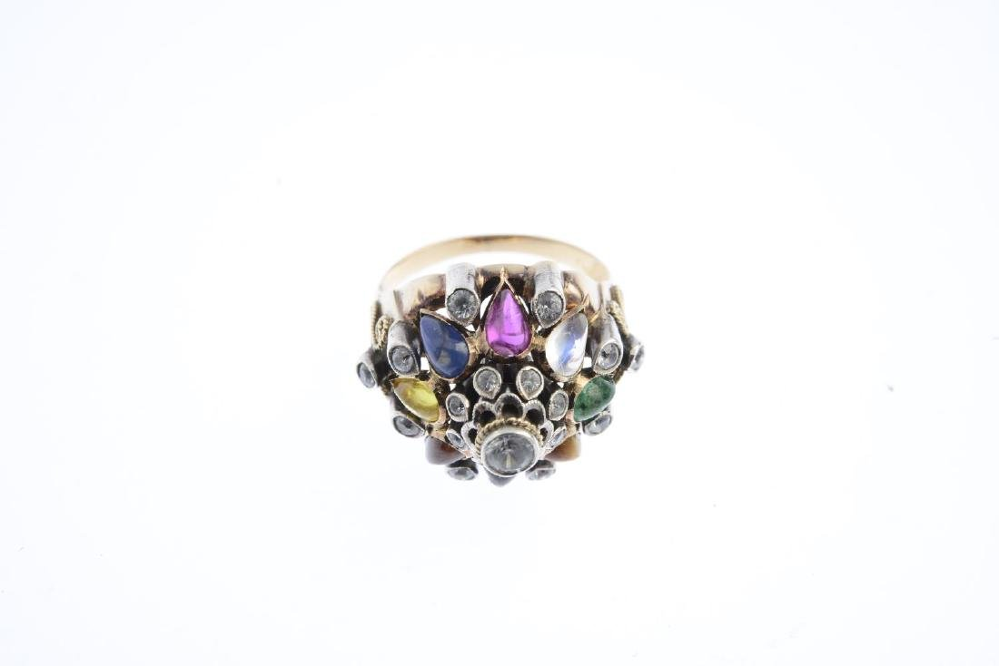 A gem-set dress ring. The circular-shape zircon collet, - 3