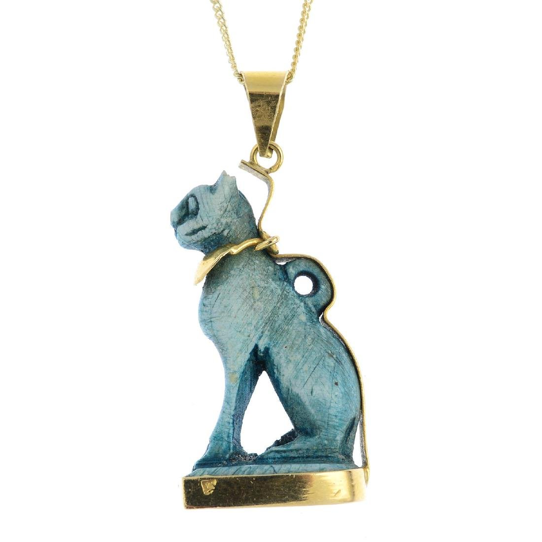 A 'Bastet' ceramic pendant. The dyed bluish-green