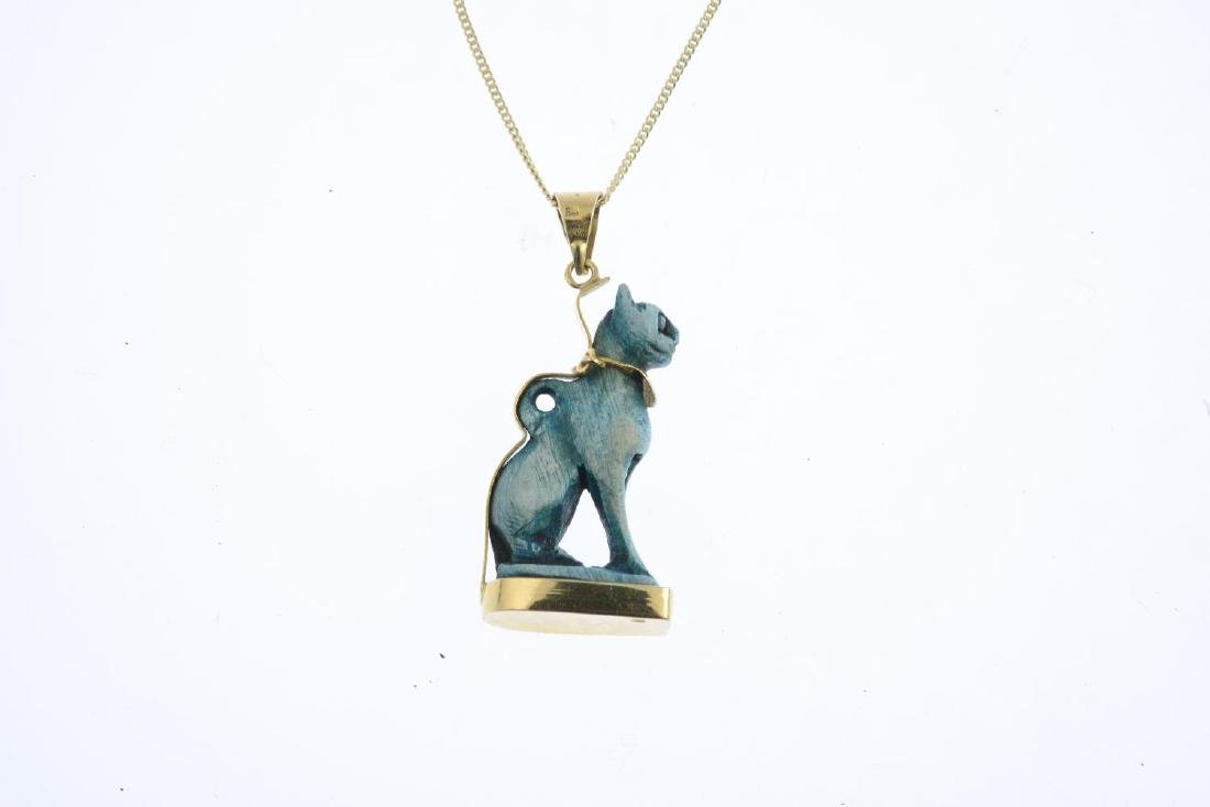 A 'Bastet' ceramic pendant. The dyed bluish-green - 2