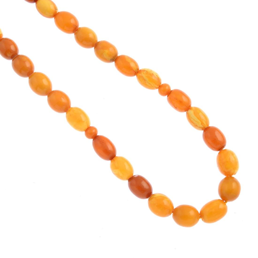A natural Baltic amber bead strand. Comprising