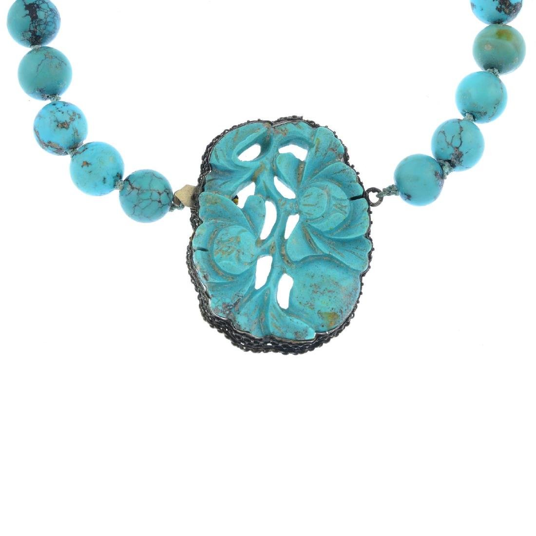 A Chinese carved turquoise necklace. Comprising a