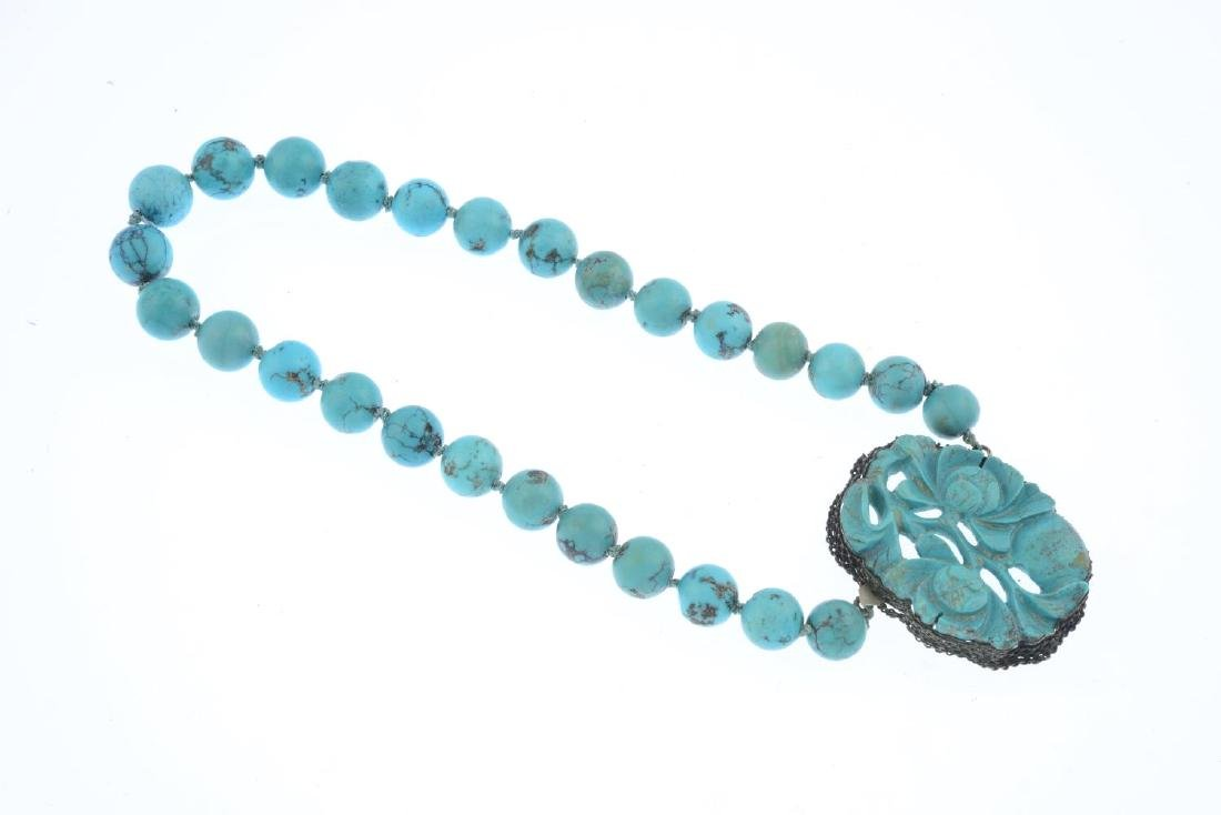 A Chinese carved turquoise necklace. Comprising a - 2