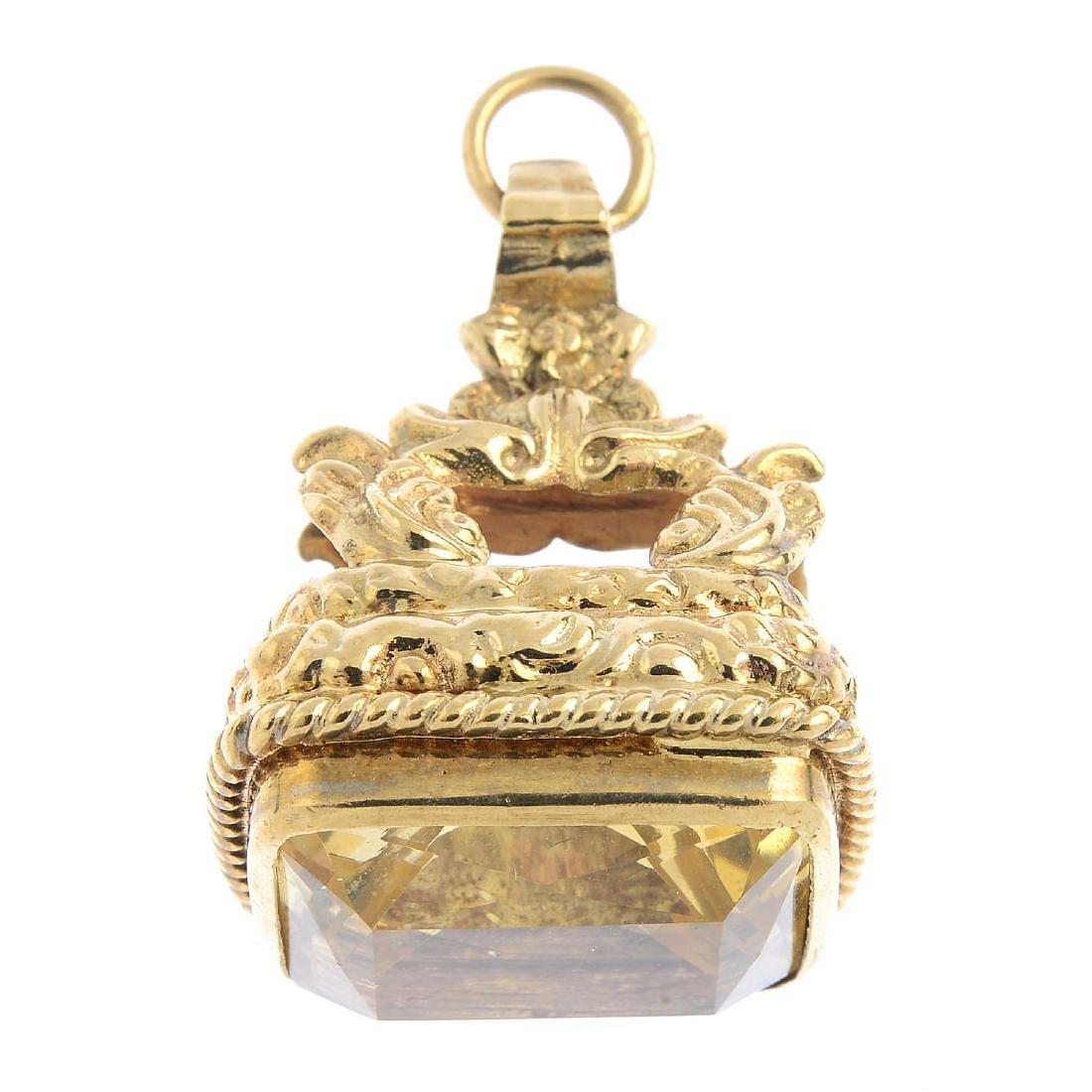 A 9ct gold citrine fob. The rectangular-shape citrine,
