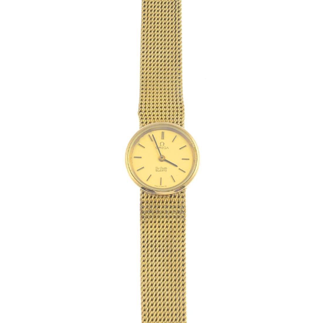 OMEGA - a lady's wrist watch. The circular dial with