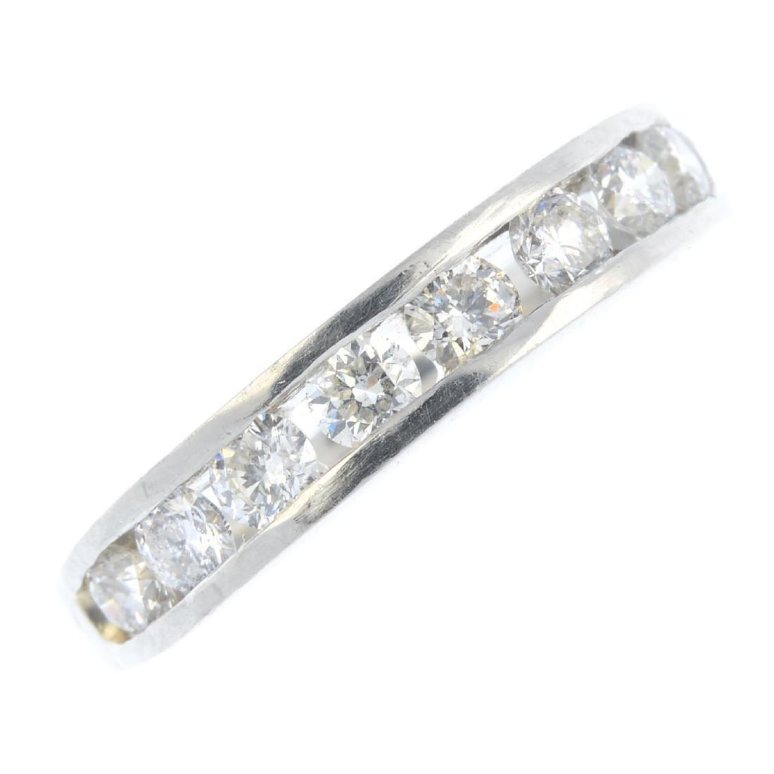 A platinum diamond half eternity ring. The