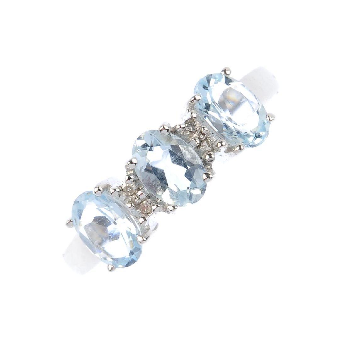 A set of aquamarine and diamond jewellery. The 9ct gold