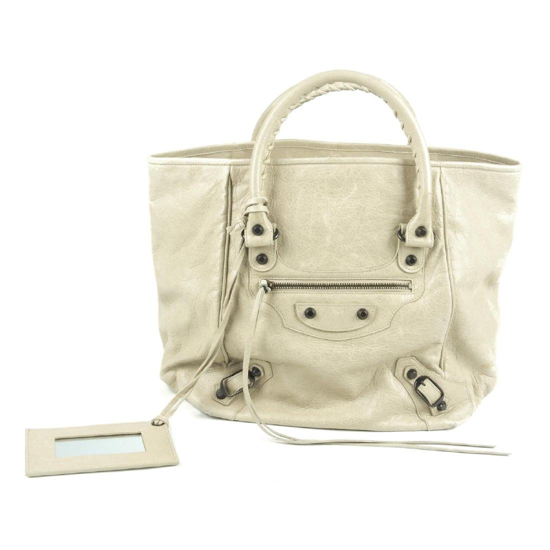 BALENCIAGA - a beige Sunday Tote handbag. Crafted from