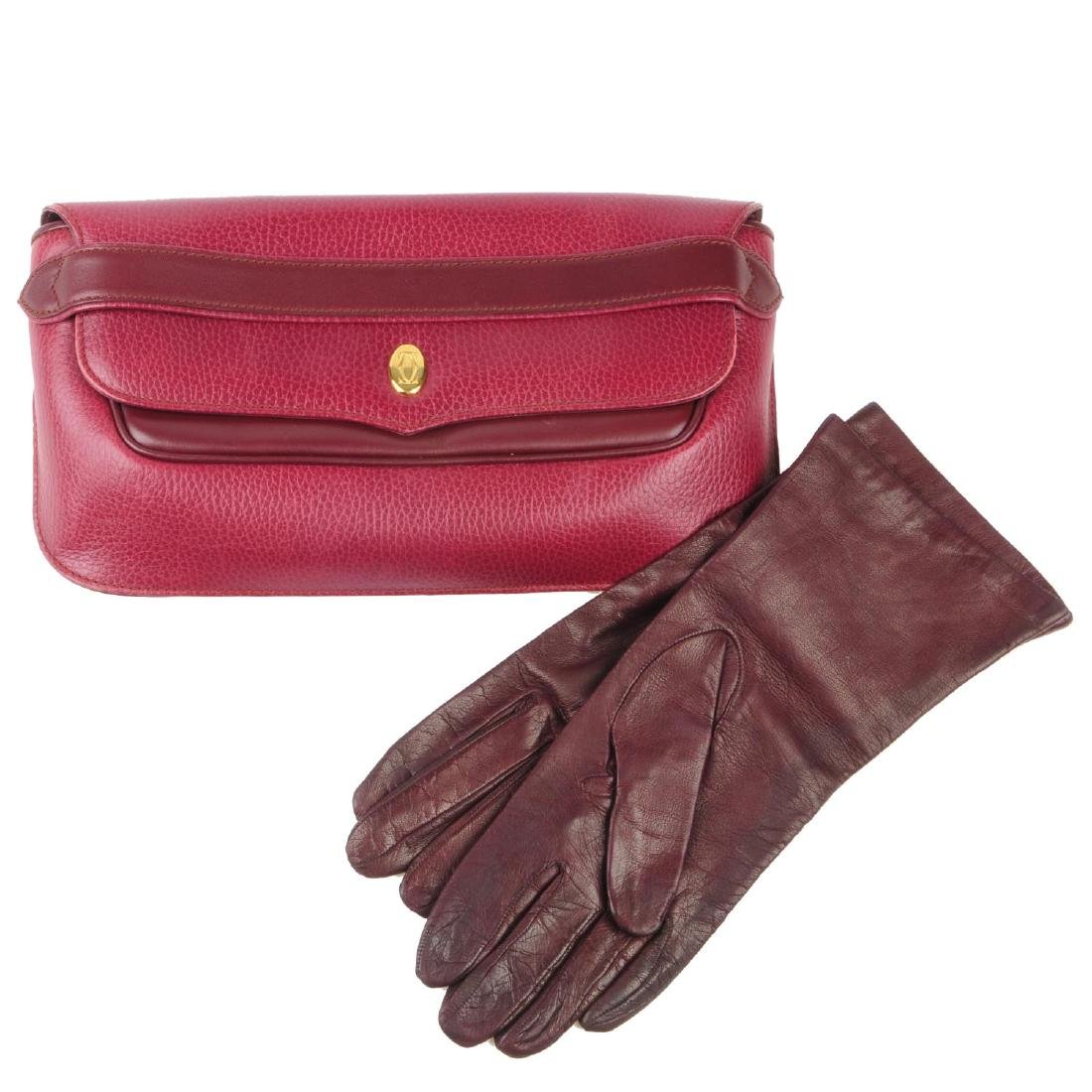 CARTIER - a Bordeaux leather clutch and a pair of