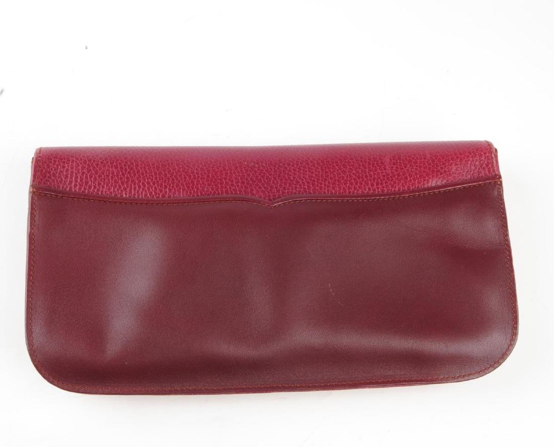 CARTIER - a Bordeaux leather clutch and a pair of - 3